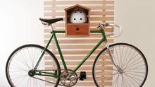 Lauren Thomas's birdhouse inspired bike rack is made of made of mahogany and plywood.