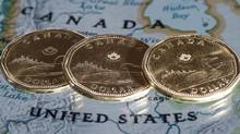 Canadian dollar coins. (Paul Chiasson/THE CANADIAN PRESS)