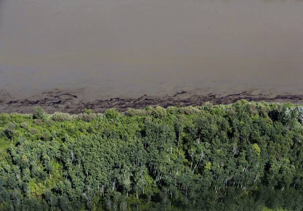 Oil is seen on the North Saskatchewan river near Maidstone on July 22, 2016. Officials say more assessments are needed before the river can be used as a drinking water source.