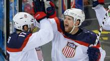 USA forward Phil Kessel, right, reacts to his goal with teammate Ryan Kesler during the third period of men's quarter-inal hockey game against the Czech Republic in Shayba Arena at the 2014 Winter Olympics, Wednesday, Feb. 19 in Sochi, Russia. (Matt Slocum/Associated Press)