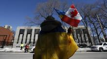 A demonstrator takes part in a protest against the referendum in Ukraine's Crimea region outside the Russian embassy in Ottawa on March 16, 2014. (CHRIS WATTIE/REUTERS)