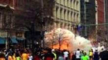 In this image from video provided by WBZ TV, spectators and runners run from what was described as twin explosions that shook the finish line of the Boston Marathon, Monday, April 15, 2013, in Boston. (WBZTV/AP Photo)