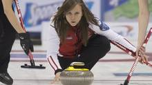 Team Canada skip Rachel Homan delivers her rock against team Quebec during fourth draw curling action at the Scotties Tournament of Hearts in Montreal, Sunday, February 2, 2014. (Graham Hughes/THE CANADIAN PRESS)