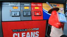 A customer holds a gas nozzle in Oakville, Ont., April 20, 2011. (Richard Buchan/RICHARD BUCHAN/THE CANADIAN PRESS)