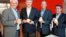 Prime Minister Stephen Harper, British Columbia Premier Gordon Campbell, Minister of International Trade Stockwell Day and minister of state for sport Gary Lunn display the medals of the 2010 Vancouver Olympic Games. (PMO photo by Jason Ransom)