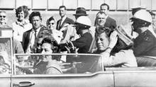 John F. Kennedy, sitting beside his wife, in the minutes before he was killed. (Associated Press)