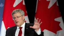 Prime Minister Stephen Harper participates in a question and answer session with the Greater Kitchener Waterloo and the Cambridge Chambers of Commerce in Kitchener, Ont., on Friday, April 25, 2014. (Nathan Denette/The Canadian Press)