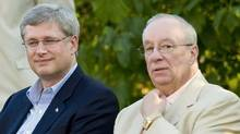 Prime Minister Stephen Harper joins Senator Jacques Demers at a Conservative rally in Montreal on Sept. 1, 2010. (Graham Hughes/THE CANADIAN PRESS)