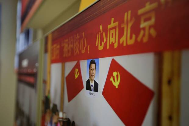 Oct. 10, 2017: A picture shows Chinese President Xi Jinping's portrait during an exhibition in Beijing displaying China's achievements for the past five years.