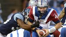 Montreal Alouettes quarterback Tanner Marsh is sacked by Toronto Argonauts' Matt Black during first half CFL action in Toronto on Tuesday September 3, 2013. (FRANK GUNN/THE CANADIAN PRESS)