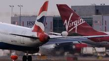 "Nigeria's Civil Aviation Authority said it was fining British Airways $135-million and Virgin Atlantic $100-million for what it called ""abuse of a dominant position, fixing prices, abusing fuel surcharges and taking advantage of passengers."" (Max Nash/AFP/Getty Images/Max Nash/AFP/Getty Images)"