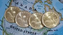 Canadian dollar coins, or loonies. (Paul Chiasson/THE CANADIAN PRESS)