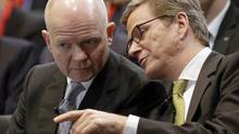 German Foreign Minister Guido Westerwelle, right, and Britain's Foreign Secretary William Hague, left, speak during the 2nd Berlin Foreign Policy Forum in Berlin, Tuesday, Oct. 23, 2012. (Michael Sohn/AP)