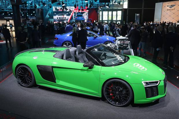 FRANKFURT AM MAIN, GERMANY - SEPTEMBER 12: Visitors look at a Audi R8 Spyder V10 Plus sports car at the 2017 Frankfurt Auto Show on September 12, 2017 in Frankfurt am Main, Germany. The Frankfurt Auto Show is taking place during a turbulent period for the auto industry. Leading companies have been rocked by the self-inflicted diesel emissions scandal. At the same time the industry is on the verge of a new era as automakers commit themselves more and more to a future that will one day be dominated by electric cars.