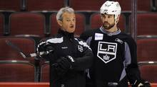 Los Angeles Kings' head coach Darryl Sutter gives instructions to Willie Mitchell during their team practice in Glendale earlier this month. (Todd Korol/Reuters/Todd Korol/Reuters)