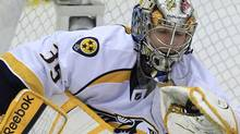 Nashville Predators goalie Pekka Rinne (35), of Finland, makes a glove-save during the third period of Game 3 of an NHL hockey Stanley Cup first-round playoff series against the Detroit Red Wings in Detroit, Sunday, April 15, 2012. (AP Photo/Carlos Osorio) (Carlos Osorio)