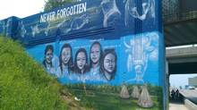 A mural on Portage Avenue in Winnipeg shows the faces of missing and murdered aboriginal women, as created by artist Tom Andrich. (CHRISD.CA)