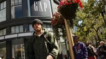 Pedestrians walk outside the Gap flagship store in San Francisco, August 19, 2010. (ROBERT GALBRAITH/REUTERS)