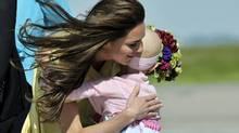 The Duchess of Cambridge hugs six-year-old Diamond Marshall as the Royal Couple arrives in Calgary Thursday, July 7, 2011. (Nathan Dentte / The Canadian Press/Nathan Dentte / The Canadian Press)