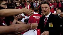 Manchester United's new manager Louis van Gaal signs autographs (Jon Super/AP)