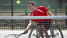 Wheelchair tennis player and paralympic hopeful Joel Dembe trains with his coach in Toronto. (Kevin Van Paassen/The Globe and Mail)
