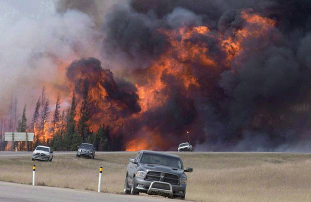 Last year's Fort McMurray wildfire, shown in this May 7, 2017 file photo, destroyed nearly 1,600 buldings.