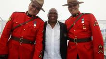 Former Montreal Expos player Tim Raines poses for photos with Royal Canadian Mounted Police officers Rick Steeves, left, and Jim Ogden after the 2013 induction ceremony for the Canadian Baseball Hall of Fame, Saturday June 29, 2013 in St. Mary's, Ontario (Dave Chidley/THE CANADIAN PRESS)