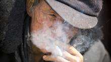 A man smokes a cigarette in Lower Qiantan, China January 14, 2013. (John Lehmann/The Globe and Mail)