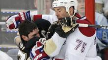 Pittsburgh Penguins Sidney Crosby (L) collides with Montreal Canadiens Hal Gill during the second period of action in Game 2 of their NHL Eastern Conference semi-final hockey series in Pittsburgh, Pennsylvania, May 2, 2010. REUTERS/Jason Cohn (JASON COHN)