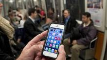 The new spectrum will allow carriers to boost their network capacity and meet the demand for more data, and to provide new and faster services. (Ryan Remiorz/THE CANADIAN PRESS)