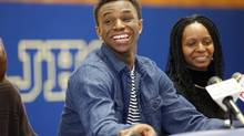 Andrew Wiggins smiles along side his mother Marita Payne-Wiggins, right, during a ceremony, Tuesday, May 14, 2013, in Huntington W.Va. (Sholten Singer/AP)