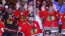 Fans celebrate a second period goal scored by Patrick Sharp in Game 1 of the NHL Western Conference final hockey playoff game against the Los Angeles Kings in Chicago, Illinois, June 1, 2013. (JEFF HAYNES/REUTERS)