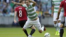 Celtic's Mikael Lustig, right, and Legia Warsaw's Ondrej Duda battle for the ball during their Champions League qualifying soccer match at Murrayfield, Edinburgh, Wednesday Aug. 6, 2014. (Jeff Holmes/AP)