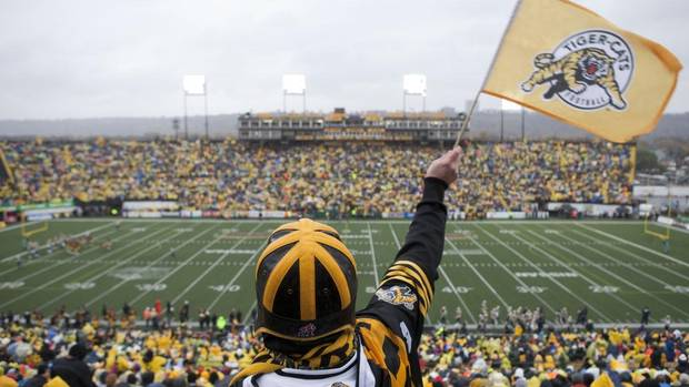 A fan waves a flag as the Hamilton Tiger-Cats and the Winnipeg Blue Bombers play at Ivor Wynne Stadium in Hamilton, ON, on Saturday, October 27, 2012.  (Matthew Sherwood/The Globe and Mail)