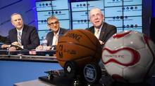 From left, BCE CEO George Cope, Rogers Communications CEO Nadir Mohamed and MLSE chairman Larry Tanenbaum attend a news conference announcing the sale of MLSE in Toronto Dec. 9, 2011. (MARK BLINCH/REUTERS)