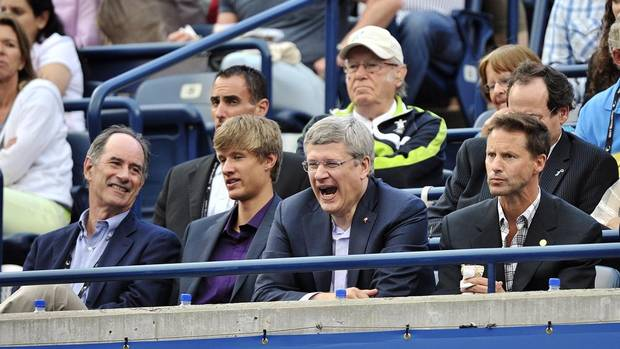 Prime Minister Stephen Harper yawns while watching Novak Djokovic of Serbia play against Richard Gasquet of France during final round Rogers Cup tennis action in Toronto on Sunday, August 12, 2012. (Nathan Denette/THE CANADIAN PRESS)