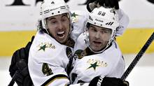 Dallas Stars Brenden Dillon (4) celebrates his goal against the Vancouver Canucks with teammate Jaromir Jagr during the third period of their NHL hockey game in Vancouver, British Columbia February 15, 2013. (ANDY CLARK/REUTERS)