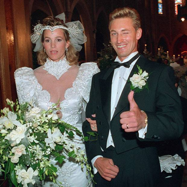 Wayne Gretzky gives a thumbs-up as he and his wife Janet Jones leave St. Joseph's Basilica July 16, 1988 after being wed before 700 friends and relatives in Edmonton.