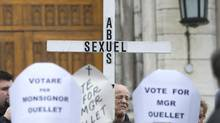 Alleged victims of abuse at the hands of priests demonstrate outside a church in Montreal, on March 10, 2013. A Quebec association of victims of priests is throwing its support behind Cardinal Marc Ouellet, but not necessarily because it feels he's the best candidate to become pope. (Graham Hughes/The Canadian Press)