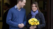Britain's Prince William stand next to his wife Kate, Duchess of Cambridge as she leaves the King Edward VII hospital in central London, Thursday, Dec. 6, 2012. Prince William and his wife Kate are expecting their first child, and the Duchess of Cambridge was admitted to hospital suffering from a severe form of morning sickness in the early stages of her pregnancy. (Alastair Grant/AP)