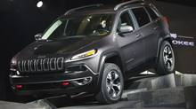 A 2014 Jeep Cherokee drives across a stage after being unveiled at the New York International Auto Show in New York, March 27, 2013. (LUCAS JACKSON/REUTERS)