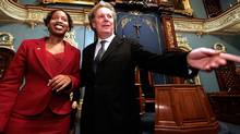 Quebec Premier Jean Charest, right, guides newly sworn in member Yolande James in the Quebec legislature Monday Oct. 28, 2004. (JACQUES BOISSINOT)
