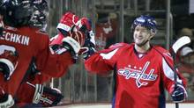 Washington Capitals' Michael Nylander, of Sweden, celebrates with teammates after scoring a goal on a penalty shot against the Vancouver Canucks during the second period of an NHL hockey game, Monday, Oct. 13, 2008, in Washington. (AP Photo/Luis M. Alvarez) (Luis M. Alvarez)