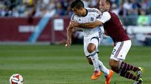 Colorado Rapids midfielder Nick LaBrocca, right, and Vancouver Whitecaps midfielder Sebastian Fernandez battle for the ball in the first half at Dick's Sporting Goods Park in Commerce City, Colo., on June 28. (Isaiah J. Downing/USA Today Sports)