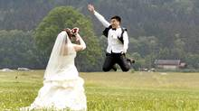 Chinese bridal couple make pictures in front of the south Bavarian castle Neuschwanstein in Schwangau near Fuessen. Thirty-one Chinese couples who already got married in China travelled to Germany to repeat their promise of marriage at Neuschwanstein Castle, one of the most popular destinations in Europe. (Michaela Rehle/Reuters/Michaela Rehle/Reuters)