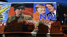 A banner depicting Cypriot President Nicos Anastasiades, and German Chancellor Angela Merkel in a Nazi uniform, was hung by protesters during an anti-bailout rally in Nicosia March 27, 2013. German policy makers feel a duty to provide the euro zone with stiff-backed leadership, making them unpopular in nations hard-hit by austerity measures. (YANNIS BEHRAKIS/REUTERS)