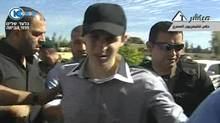 A video grab from Israel's Channel 10 accessed from Egypt TV shows Israeli soldier Gilad Shalit upon his arrival in Egypt on Oct. 17, 2011 following his release after five years of Hamas captivity. (Reuters)