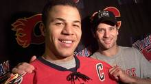 Craig Conroy (right) hands over the reins of team captain to Jarome Iginla following practice in Calgary, Alta. on Wednesday Oct. 8, 2003. (The Canadian Press)