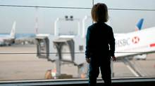 A child looks at planes in Paris-Charles de Gaulle Airport. (Bruce Kirkby/Bruce Kirby for The Globe and Mail)