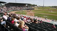 Fans taken in the sights during an Okotoks Dawgs baseball game at Seaman Stadium in Okotoks, Alta., on Sunday, July 19, 2009. (Jeff McIntosh)